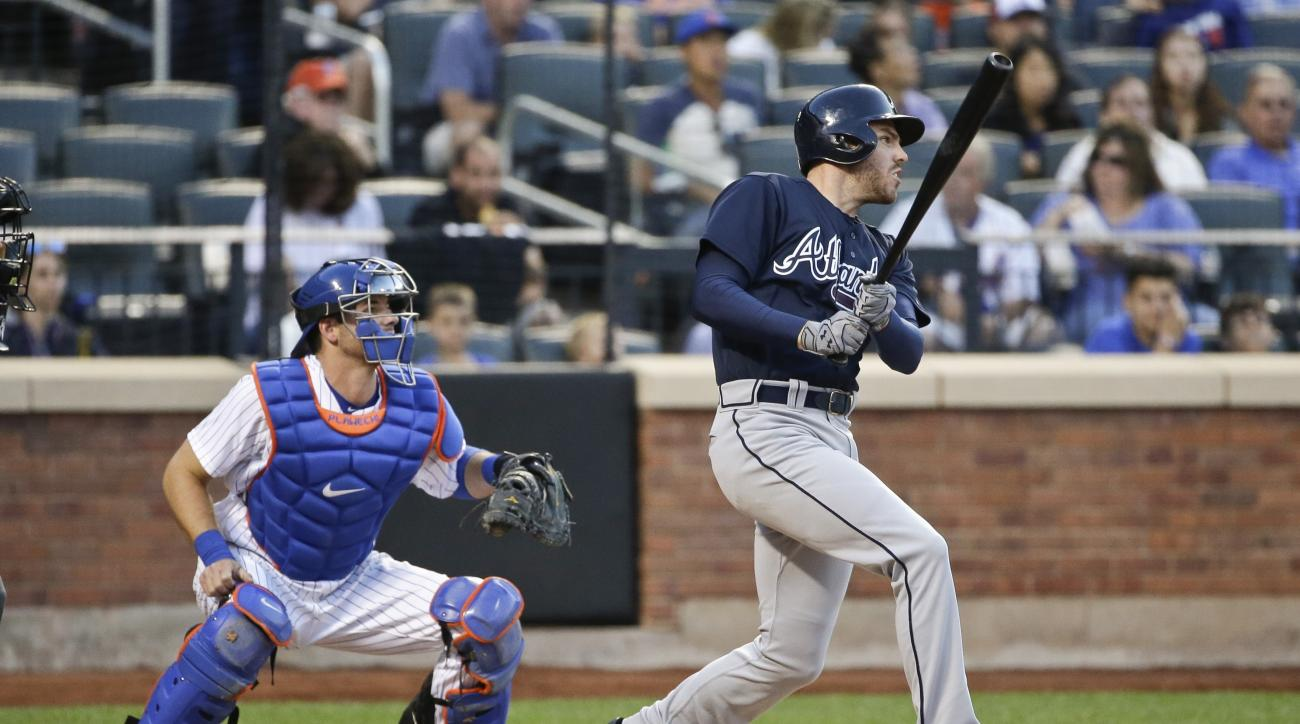 New York Mets catcher Kevin Plawecki and Atlanta Braves' Freddie Freeman watch Freeman's RBI double during the third inning of a baseball game Friday, June 17, 2016, in New York. (AP Photo/Frank Franklin II)