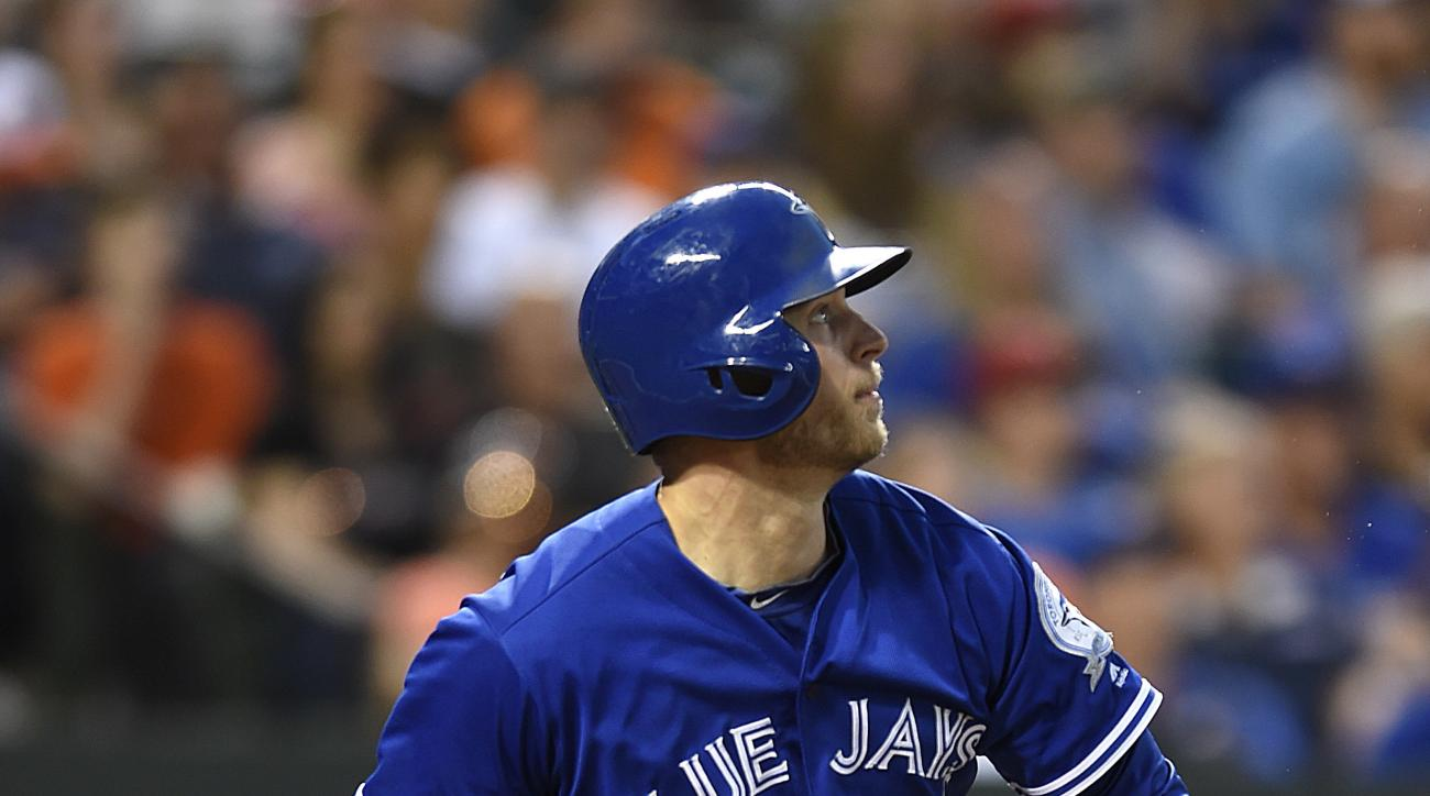 Toronto Blue Jays' Michael Saunders watches his second three-run home run leave the ball park in the fourth inning of a baseball game against the Baltimore Orioles, Friday, June 17, 2016 in Baltimore. (AP Photo/Gail Burton)