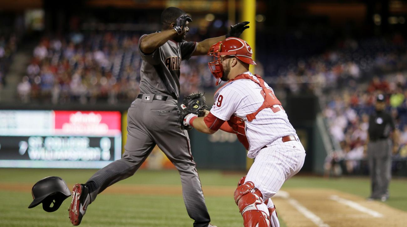 Arizona Diamondbacks' Michael Bourn, left, is tagged out by Philadelphia Phillies catcher Cameron Rupp after Bourn tried to score on double by Paul Goldschmidt during the sixth inning of a baseball game, Friday, June 17, 2016, in Philadelphia. (AP Photo/M