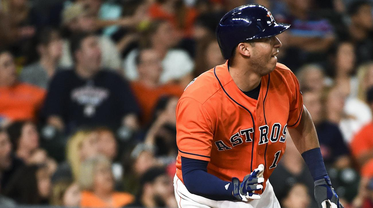 Houston Astros' Carlos Correa watches his solo home run off Cincinnati Reds relief pitcher Blake Wood during the eighth inning of a baseball game, Friday, June 17, 2016, in Houston. (AP Photo/Eric Christian Smith)