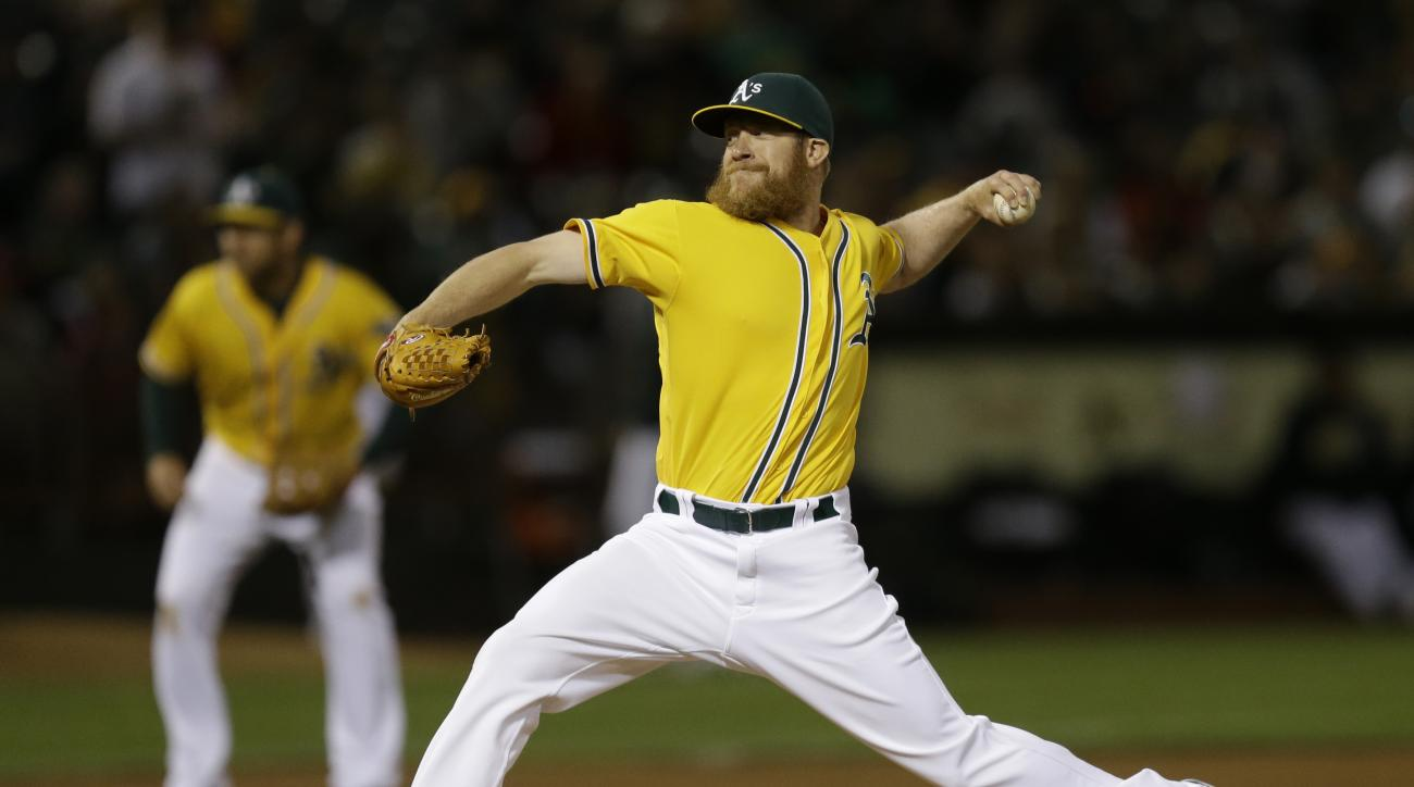 Oakland Athletics pitcher Sean Doolittle works against the Los Angeles Angels duirng the eighth inning of a baseball game Friday, June 17, 2016, in Oakland, Calif. (AP Photo/Ben Margot)