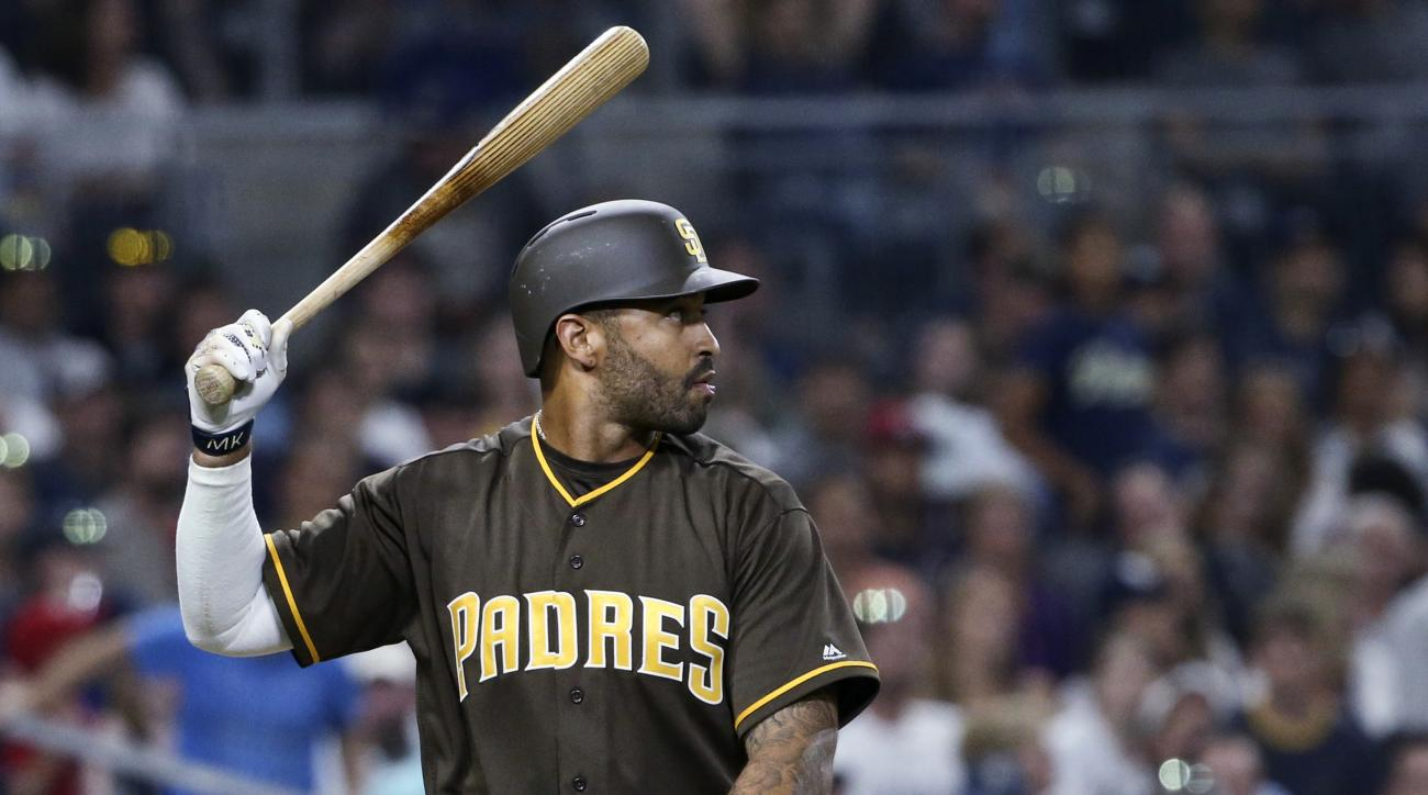 San Diego Padres' Matt Kemp holds his bat up after striking out against the Washington Nationals with two runners on base during the fifth inning of a baseball game Friday, June 17, 2016, in San Diego. (AP Photo/Lenny Ignelzi)