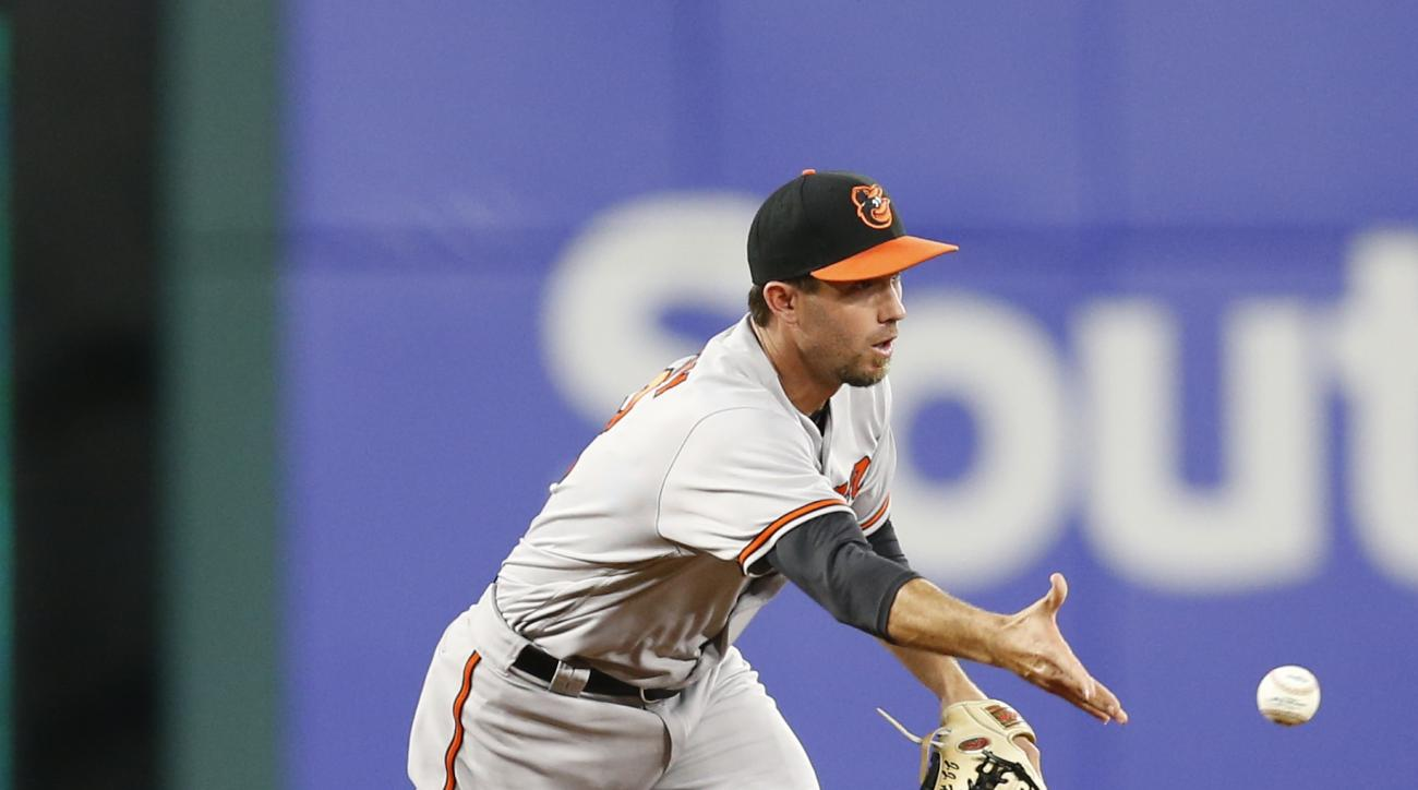 Baltimore Orioles shortstop J.J. Hardy tosses the ball hit by Texas Rangers Ryan Rua forcing out Rangers' Adrian Beltre at second base during the third inning of a baseball game, Saturday, April 16, 2016, in Arlington, Texas. (AP Photo/Jim Cowsert)
