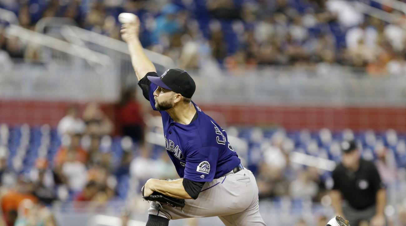 Colorado Rockies' Tyler Chatwood pitches against the Miami Marlins in the first inning of a baseball game, Saturday, June 18, 2016, in Miami. (AP Photo/Alan Diaz)
