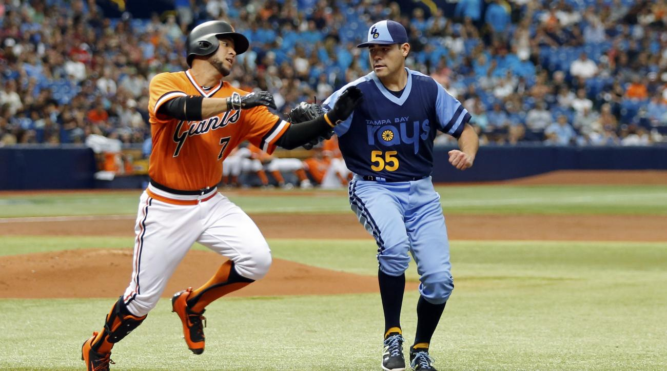 Tampa Bay Rays starting pitcher Matt Moore, right, tags out San Francisco Giants' Gregor Blanco on a sacrifice bunt during the third inning of a baseball game Saturday, June 18, 2016, in St. Petersburg, Fla. (AP Photo/Mike Carlson)