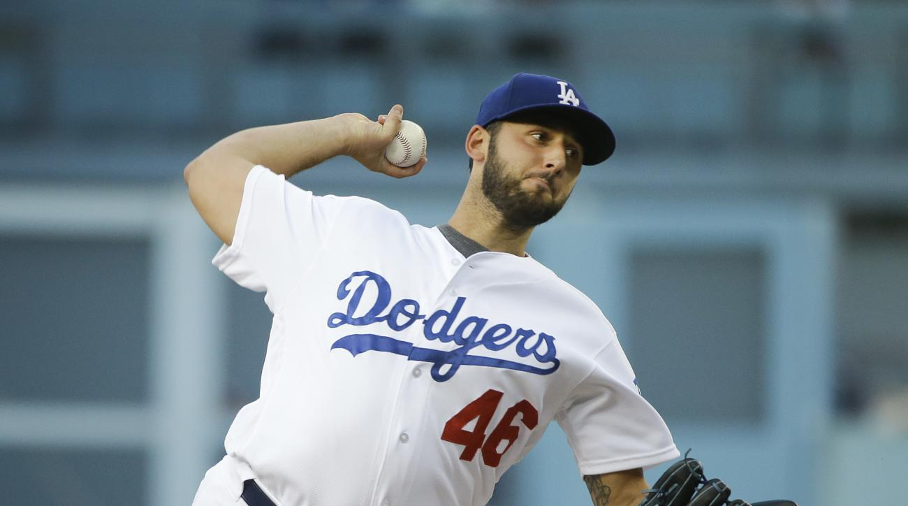 Los Angeles Dodgers starting pitcher Mike Bolsinger throws against the Milwaukee Brewers during the first inning of a baseball game Saturday, June 18, 2016, in Los Angeles. (AP Photo/Jae C. Hong)