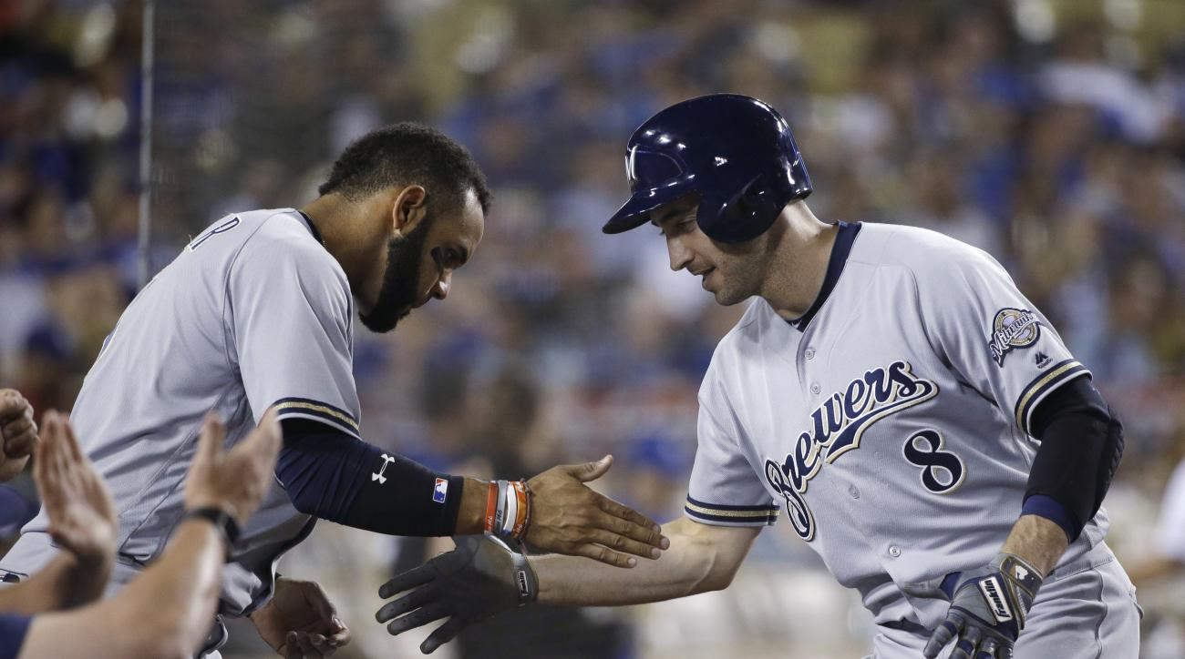 Milwaukee Brewers' Ryan Braun, right, celebrates his home run with Jonathan Villar during the seventh inning of a baseball game against the Los Angeles Dodgers, Saturday, June 18, 2016, in Los Angeles. (AP Photo/Jae C. Hong)