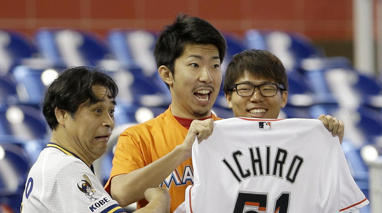 Miami Marlins fans display a jersey of Ichiro Suzuki before a baseball game against the Colorado Rockies, Sunday, June 19, 2016, in Miami. (AP Photo/Alan Diaz)
