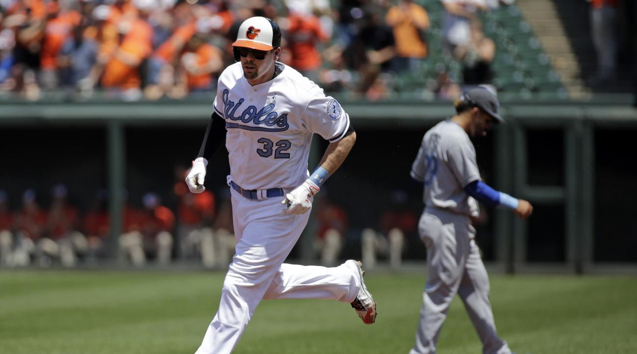 Baltimore Orioles' Matt Wieters rounds the bases after hitting a two-run home run in the first inning of a baseball game against the Toronto Blue Jays in Baltimore, Sunday, June 19, 2016. (AP Photo/Patrick Semansky)
