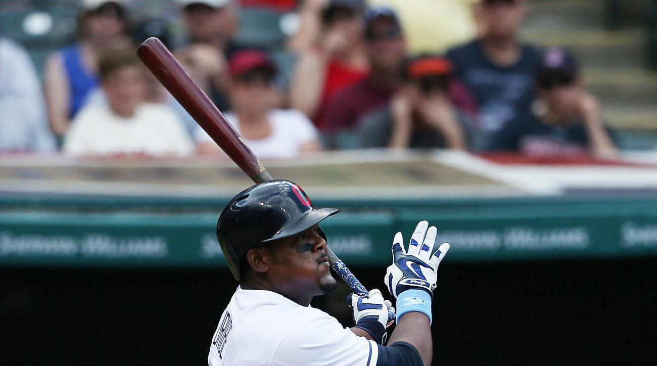 Cleveland Indians' Juan Uribe hits a solo home run off Chicago White Sox starting pitcher Carlos Rodon during the fourth inning of a baseball game, Sunday, June 19, 2016, in Cleveland. (AP Photo/Ron Schwane)