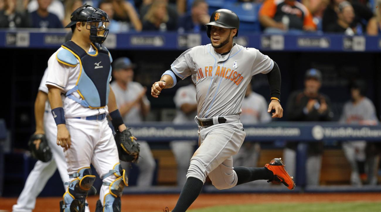 San Francisco Giants' Gregor Blanco, right, scores on a single by Joe Panik in front of Tampa Bay Rays catcher Hank Conger during the eighth inning of a baseball game Sunday, June 19, 2016, in St. Petersburg, Fla. (AP Photo/Mike Carlson)