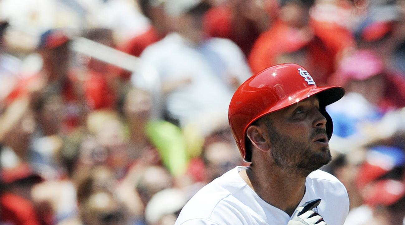 St. Louis Cardinals' Matt Holliday (7) watches his sacrifice fly against the Texas Rangers in the third inning of a baseball game, Sunday, June 19, 2016, at Busch Stadium in St. Louis. (AP Photo/Bill Boyce)