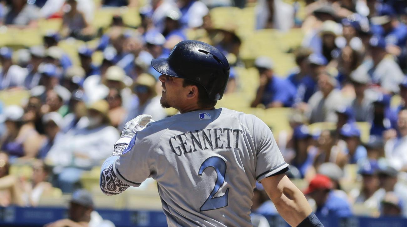 Milwaukee Brewers' Scooter Gennett watches the flight of his solo home run during the first inning of a baseball game against the Los Angeles Dodgers, Sunday, June 19, 2016, in Los Angeles. (AP Photo/Jae C. Hong)