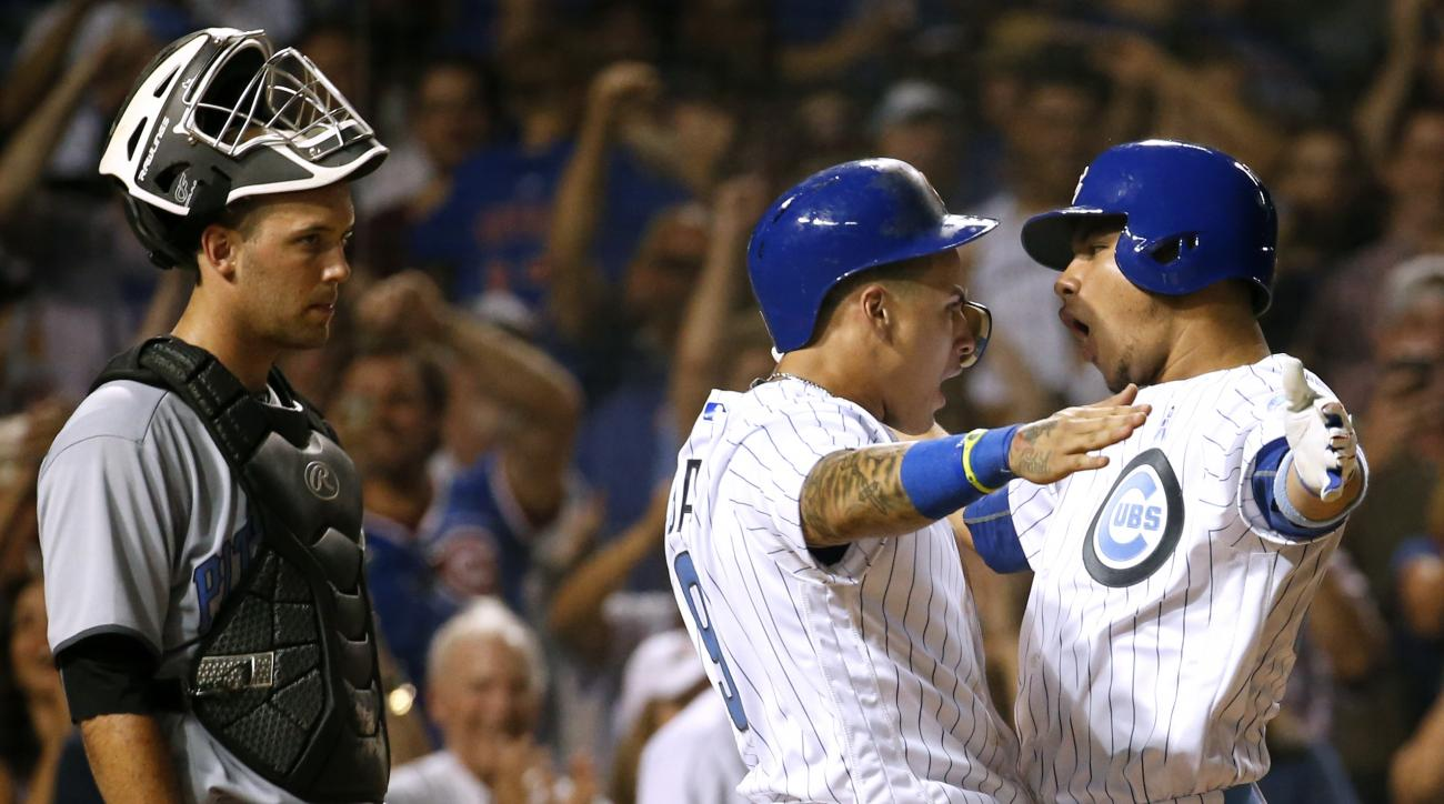 Chicago Cubs' Willson Contreras, right, celebrates with Javier Baez, center after hitting a two-run home run as Pittsburgh Pirates catcher Jacob Stallings reacts during the sixth inning of a baseball game Sunday, June 19, 2016, in Chicago. (AP Photo/Nam Y