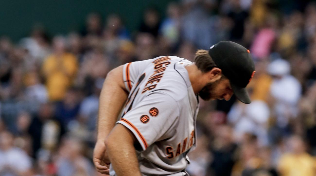 San Francisco Giants starting pitcher Madison Bumgarner tugs at his belt after giving up a solo home run to Pittsburgh Pirates' Erik Kratz during the fifth inning of a baseball game, Monday, June 20, 2016, in Pittsburgh. (AP Photo/Keith Srakocic)