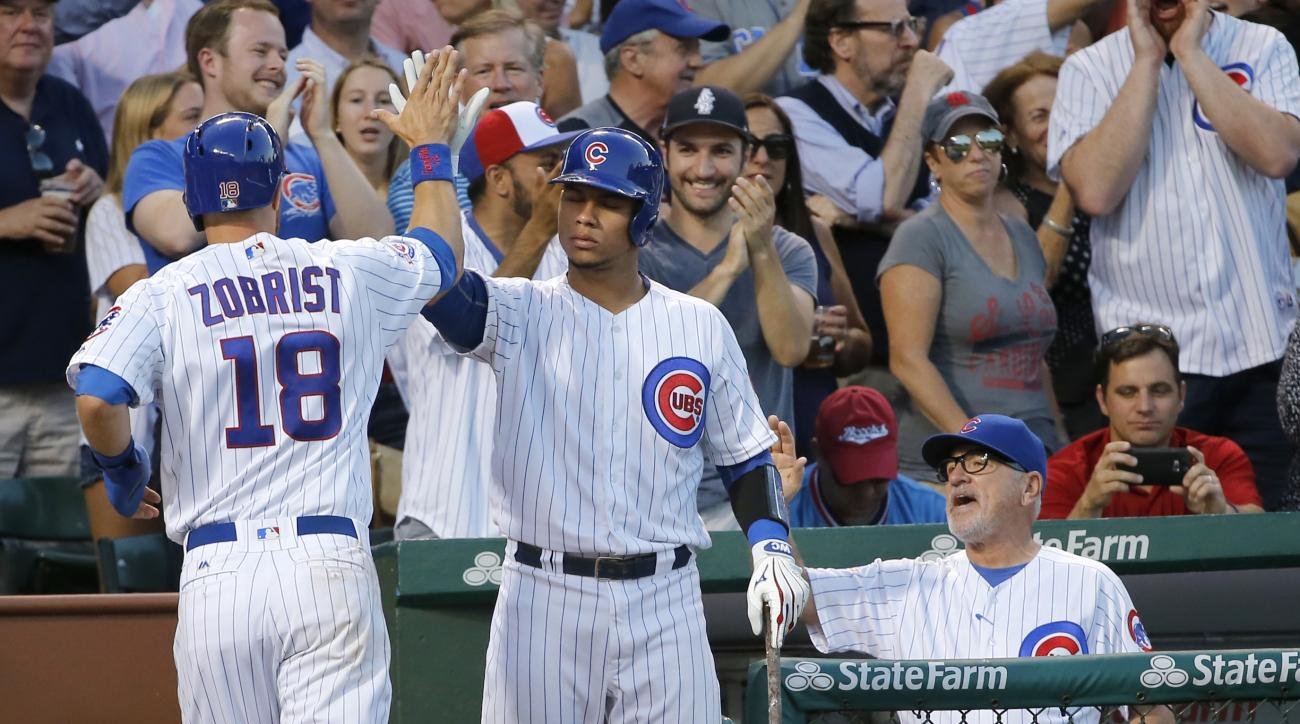 CORRECTS SPELLING TO WILLSON, INSTEAD OF WILSON - Chicago Cubs' Ben Zobrist (18) is greeted outside the dugout by Willson Contreras after Zobrist scored during the third inning of a baseball game against the St. Louis Cardinals on Monday, June 20, 2016, i