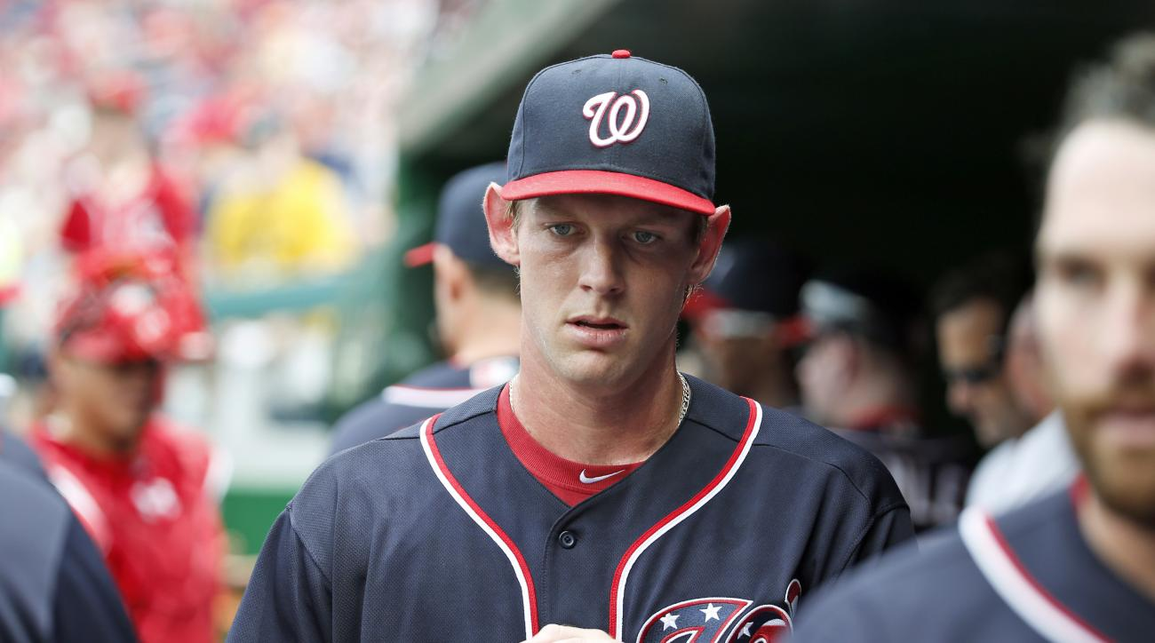 FILE - In this May 29, 2016, file photo, Washington Nationals pitcher Stephen Strasburg enters the dugout before the team's baseball game against the St. Louis Cardinals in Washington. The Nationals have scratched unbeaten right-hander Strasburg with an u