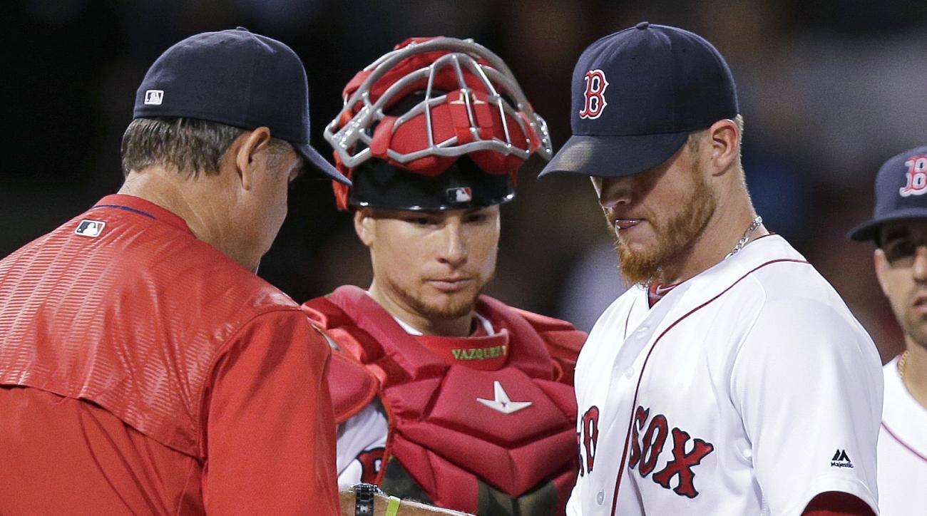 Boston Red Sox manager John Farrell, left, takes the ball from relief pitcher Craig Kimbrel after Kimbrel gave up a two-run double during the 10th inning of a baseball game at Fenway Park, Monday, June 20, 2016, in Boston. The Chicago White Sox defeated t