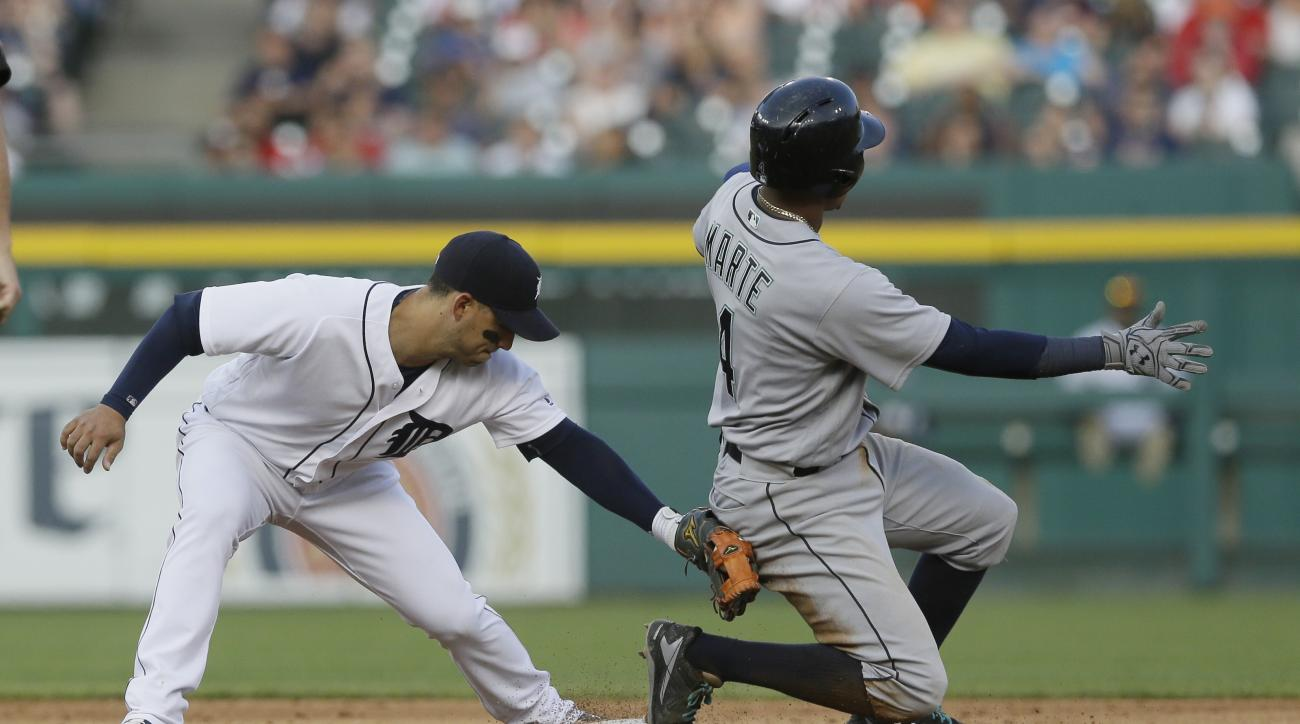 Seattle Mariners' Ketel Marte beats the tag of Detroit Tigers shortstop Jose Iglesias and takes second on a wild throw by pitcher Justin Verlander during the fourth inning of a baseball game, Tuesday, June 21, 2016, in Detroit. (AP Photo/Carlos Osorio)