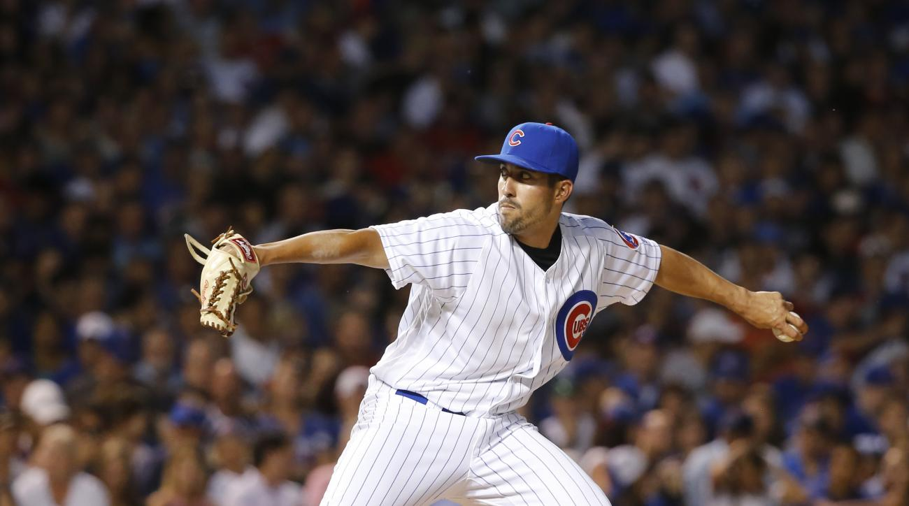 Chicago Cubs relief pitcher Gerardo Concepcion delivers in his Major League debut during the sixth inning of a baseball game against the St. Louis Cardinals Tuesday, June 21, 2016, in Chicago. (AP Photo/Charles Rex Arbogast)