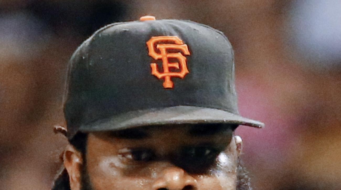 San Francisco Giants starting pitcher Johnny Cueto looks at the ball before he was lifted during the seventh inning of a baseball game against the Pittsburgh Pirates, Tuesday, June 21, 2016, in Pittsburgh. (AP Photo/Keith Srakocic)