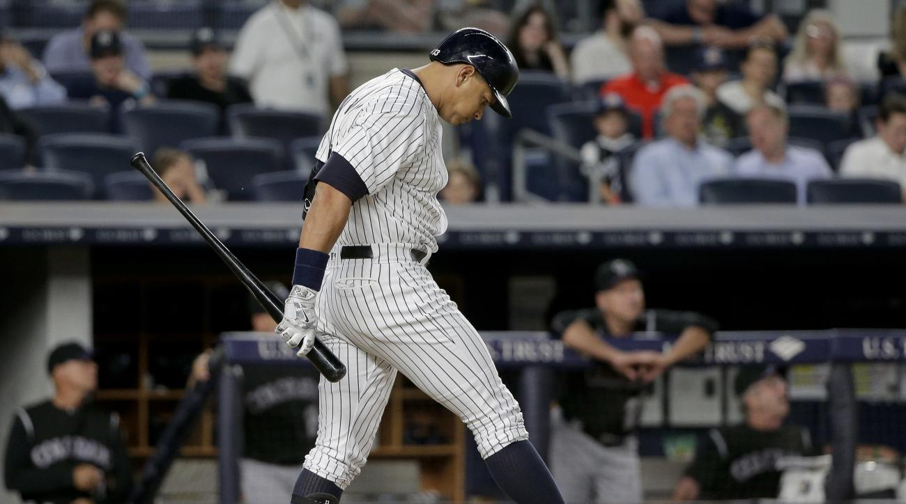 New York Yankees' Alex Rodriguez reacts after swinging and missing for a strike during the seventh inning of a baseball game against the Colorado Rockies, Tuesday, June 21, 2016, in New York. (AP Photo/Julie Jacobson)