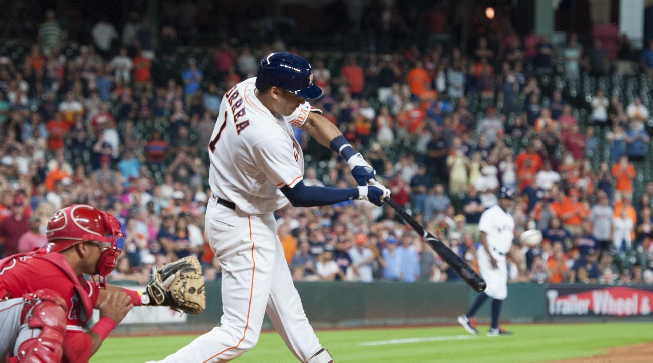 The Houston Astros Carlos Correa (1) connects on a single driving in two runs to defeat the Los Angeles Angels 3-2 in the ninth inning of a baseball game Tuesday, June 21, 2016, in Houston. (AP Photo/George Bridges)