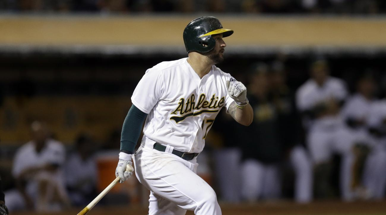 Oakland Athletics' Yonder Alonso watches his RBI single during the seventh inning of a baseball game against the Milwaukee Brewers on Tuesday, June 21, 2016, in Oakland, Calif. (AP Photo/Ben Margot)