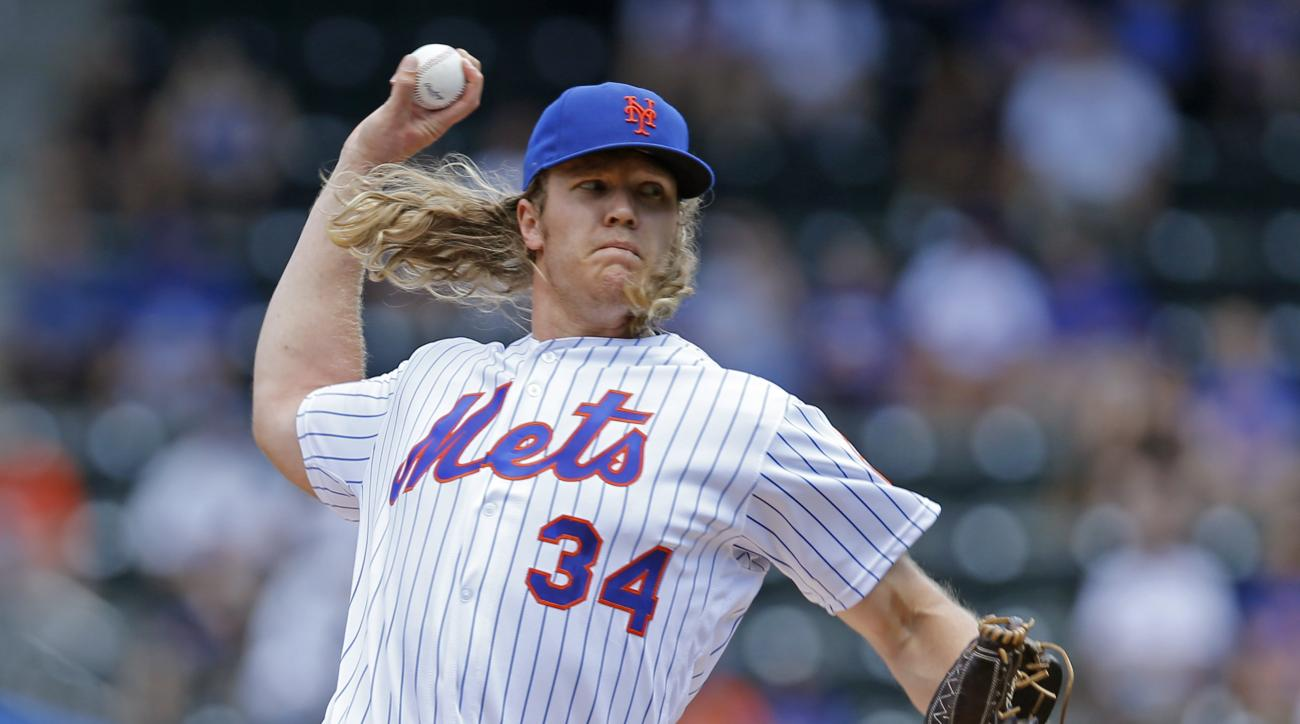 New York Mets starting pitcher Noah Syndergaard (34) delivers during the first inning of an interleague baseball game against the Kansas City Royals, Wednesday, June 22, 2016, in New York. (AP Photo/Kathy Willens)