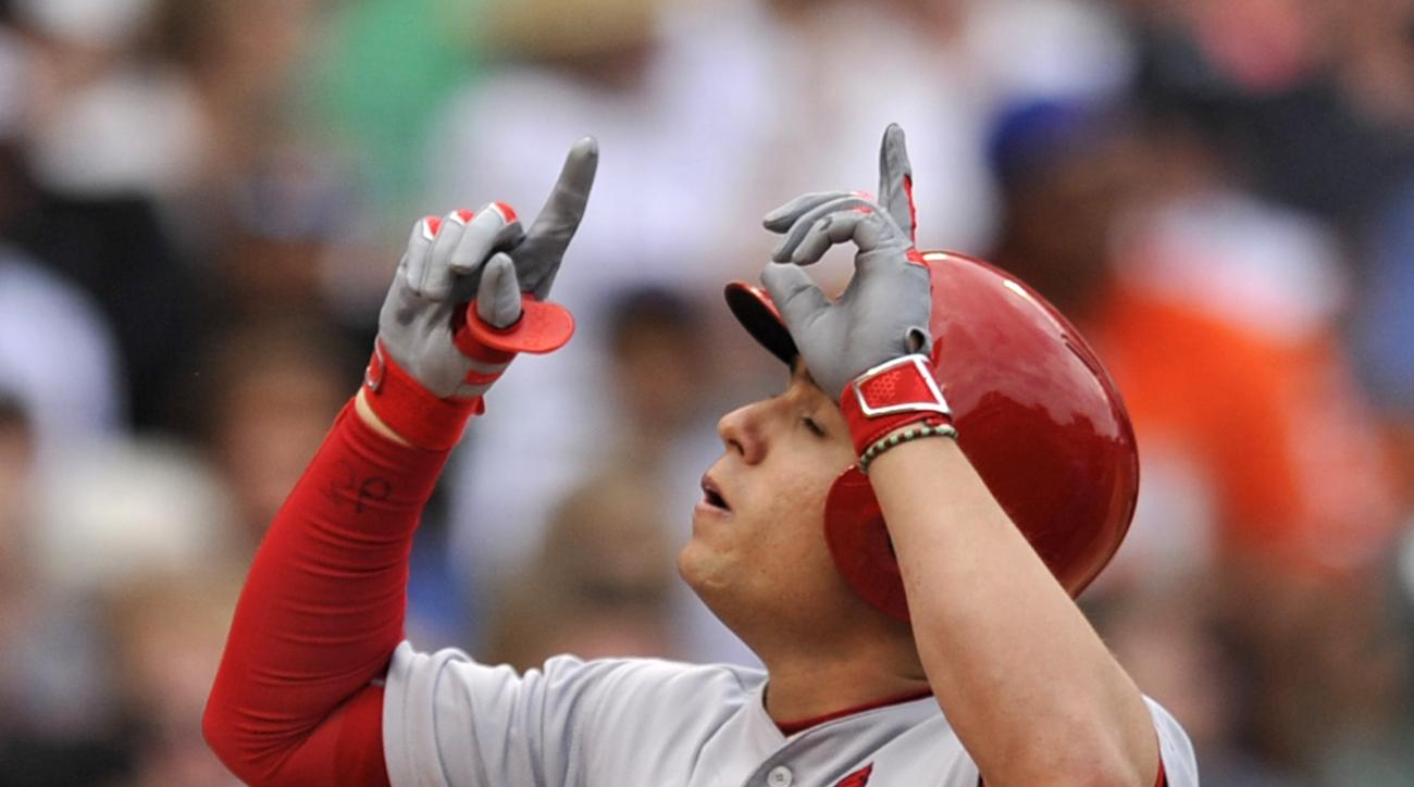 St. Louis Cardinals' Aledmys Diaz celebrates at home plate after hitting a two-run home run during the sixth inning of a baseball game against the Chicago Cubs Wednesday, June 22, 2016, in Chicago. (AP Photo/Paul Beaty)