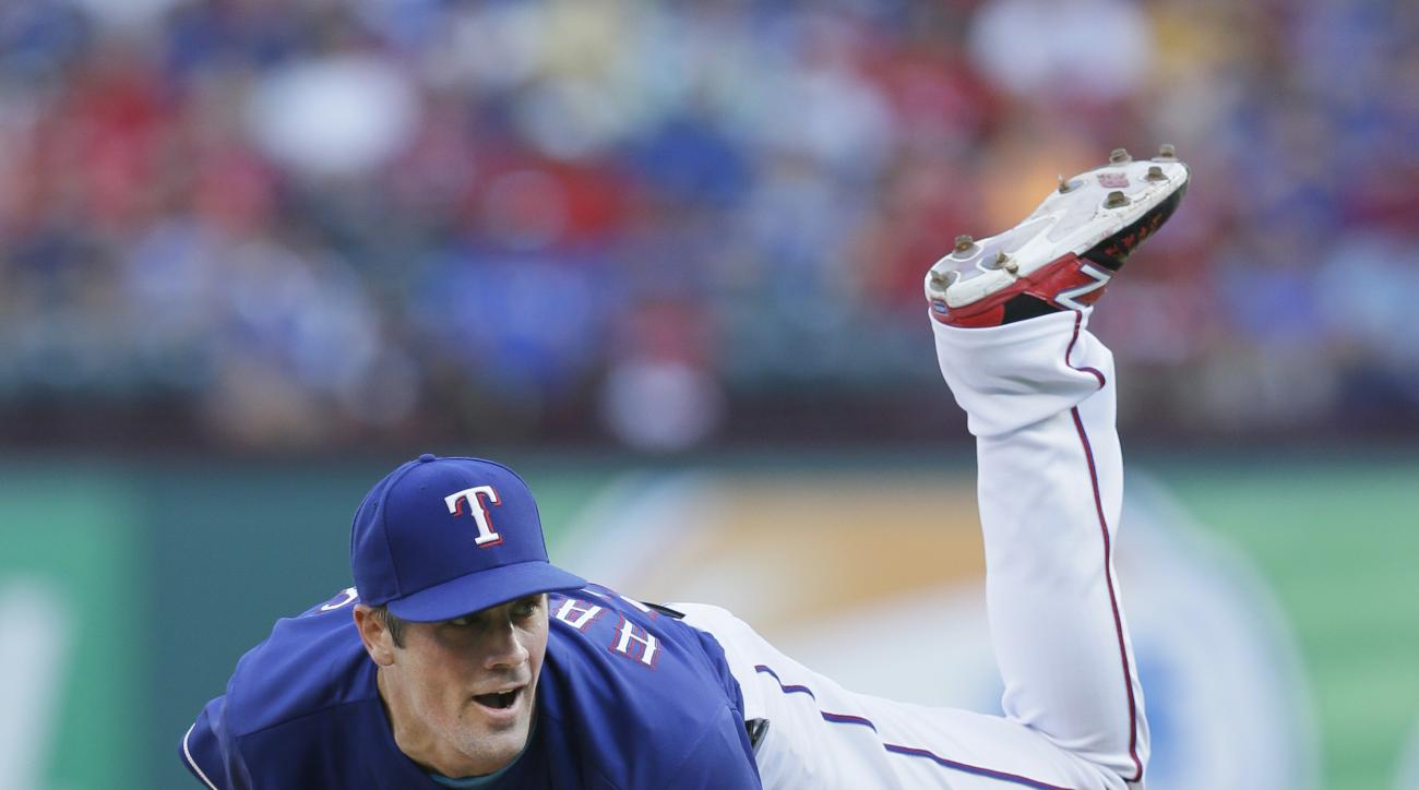 Texas Rangers starter Cole Hamels watches a pitch during the second inning of a baseball game against the Cincinnati Reds in Arlington, Texas, Wednesday, June 22, 2016. (AP Photo/LM Otero)
