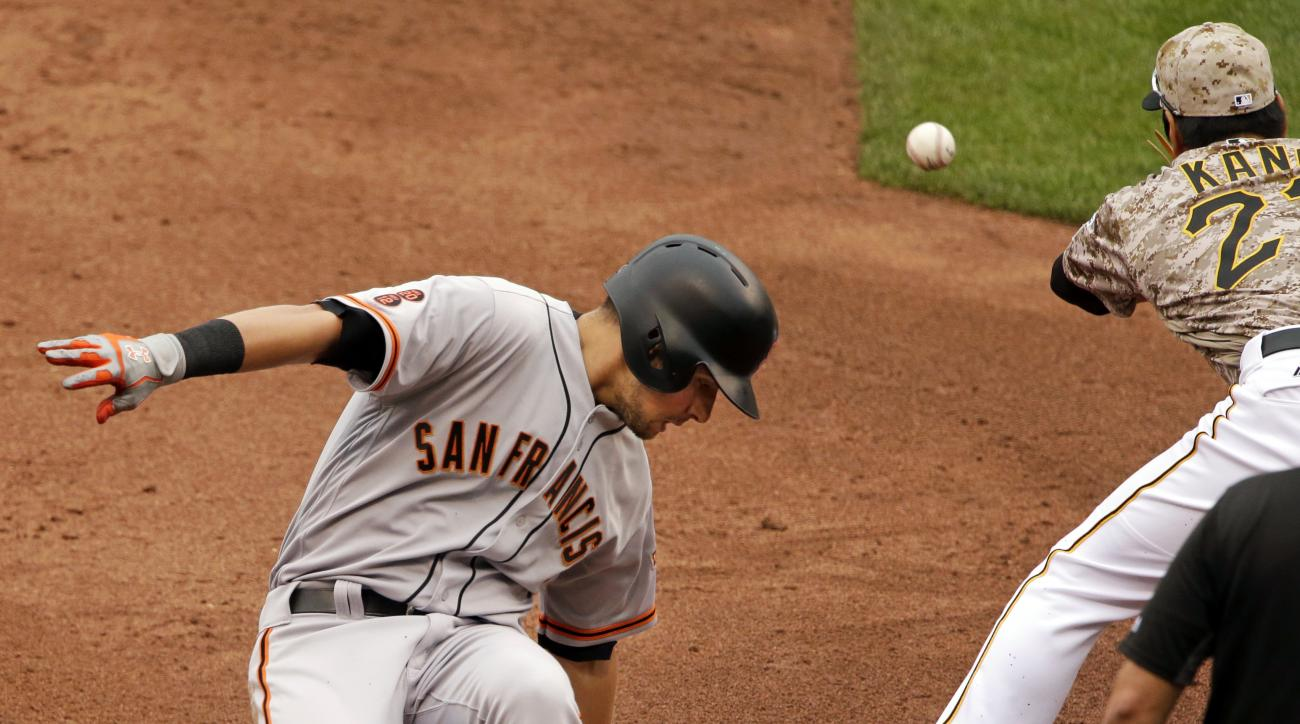 San Francisco Giants' Joe Panik, left, slides safely into third with a bases loaded triple as Pittsburgh Pirates third baseman Jung Ho Kang fields the late relay throw during the third inning of a baseball game in Pittsburgh, Thursday, June 23, 2016. (AP