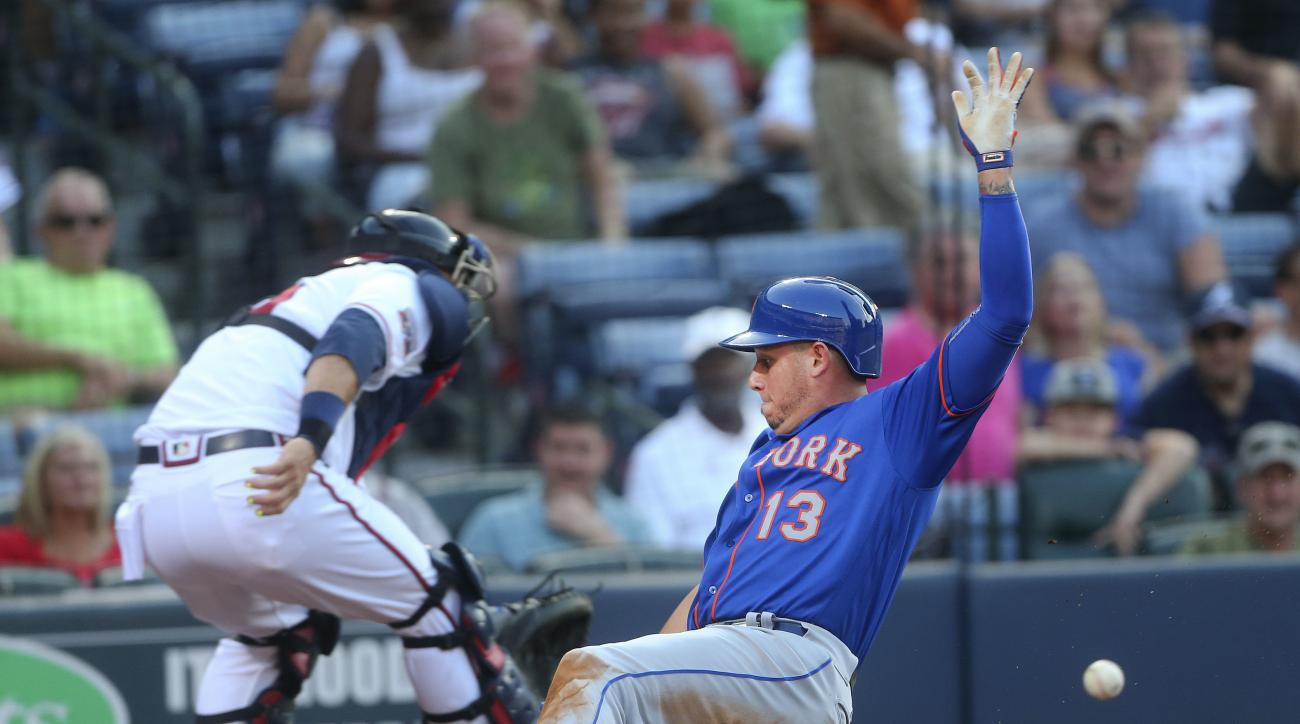 New York Mets' Asdrubal Cabrera (13) scores ahead of the throw to Atlanta Braves catcher A.J. Pierzynski on sacrifice fly by Neil Walker in the third inning of a baseball game Thursday, June 23, 2016, in Atlanta. (AP Photo/John Bazemore)