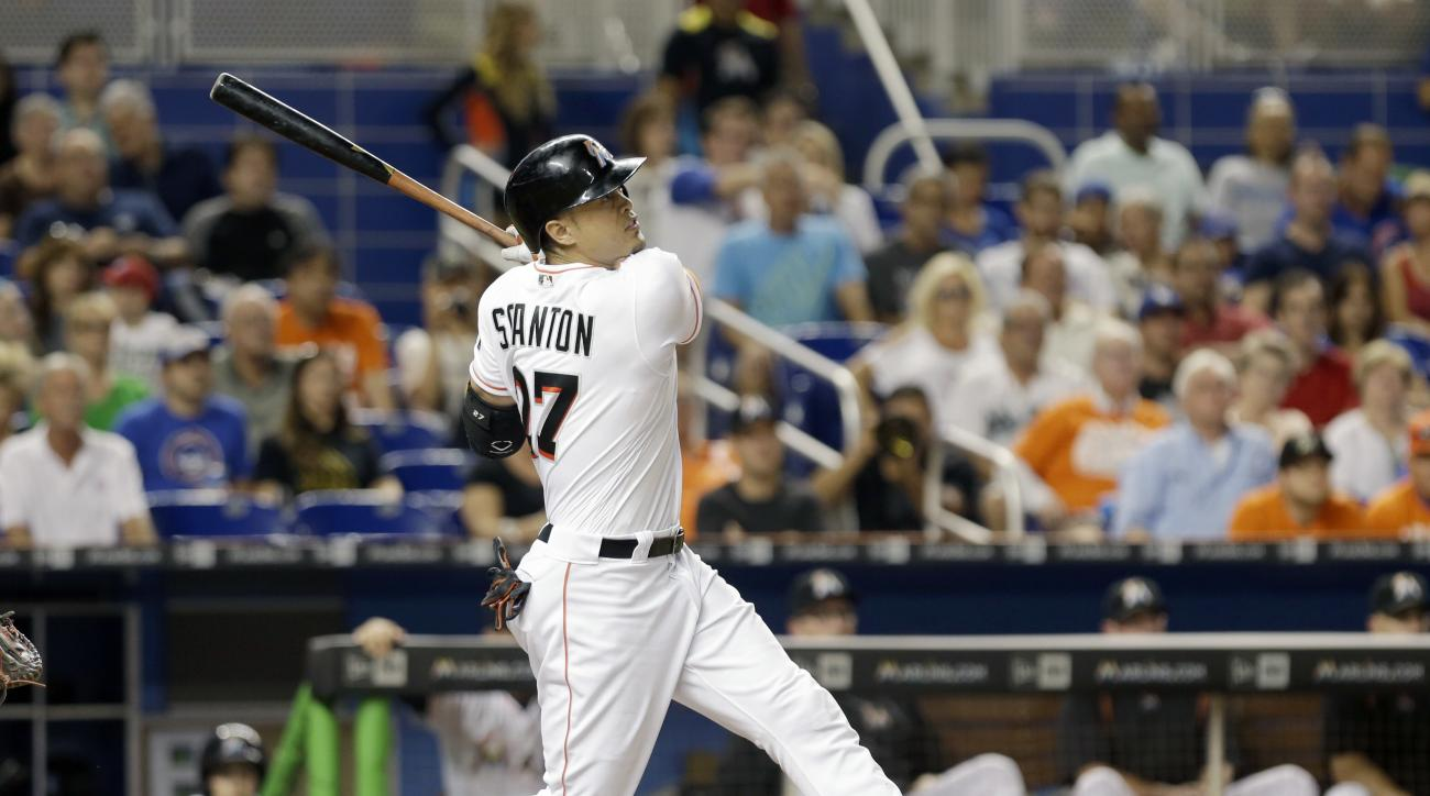 Miami Marlins' Giancarlo Stanton follows through on a solo home run against the Chicago Cubs in the fourth inning of a baseball game, Thursday, June 23, 2016, in Miami. (AP Photo/Alan Diaz)