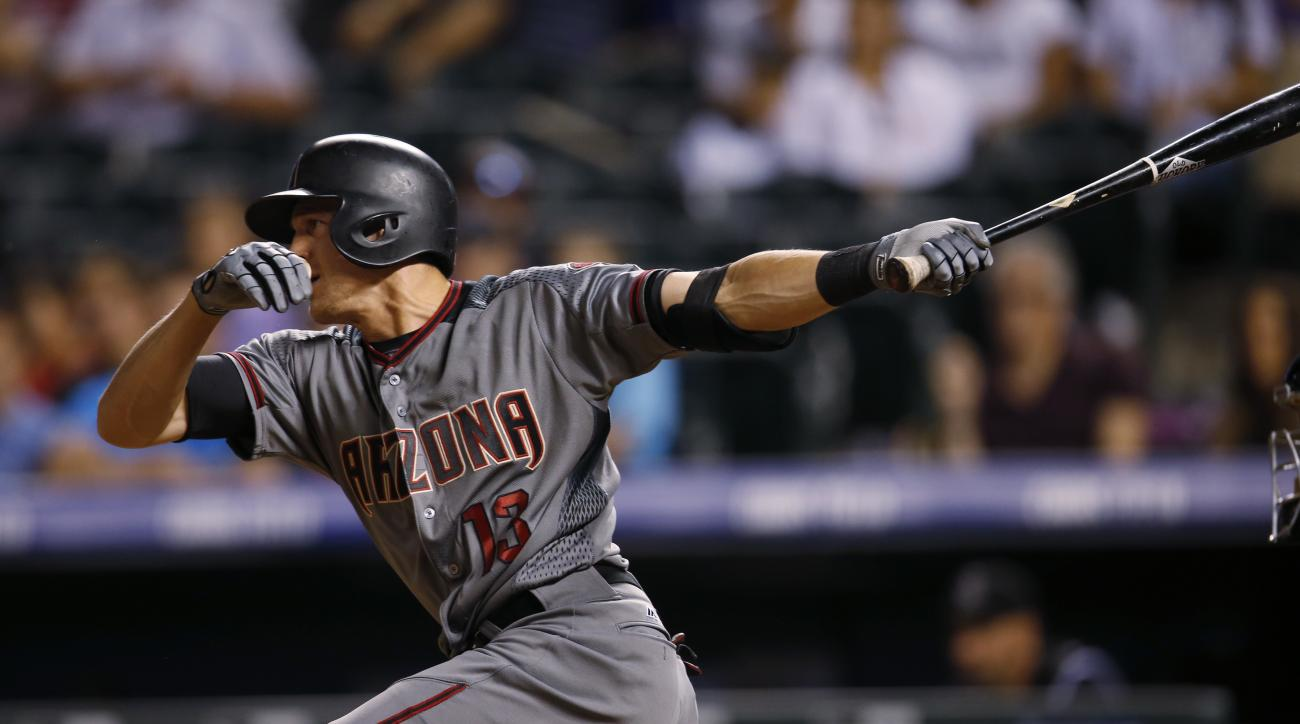 Arizona Diamondbacks' Nick Ahmed follows the flight of his RBI-single off Colorado Rockies relief pitcher Carlos Estevez to drive in the go-ahead run in the ninth inning of a baseball game Thursday, June 23, 2016, in Denver. The Diamondbacks won 7-6. (AP