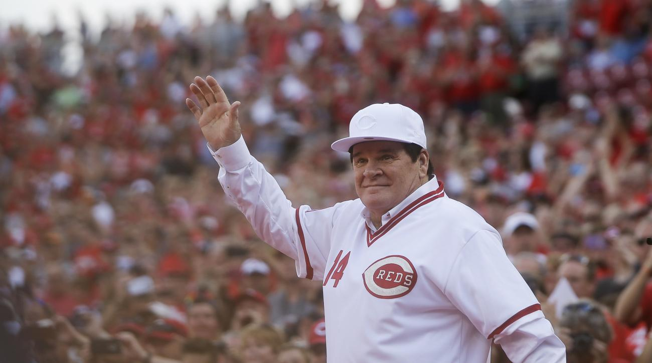Former Cincinnati Red Pete Rose waves to the crowd as he is introduced on the field during a ceremony to honor the 1976 World Series champions team, before the Reds' baseball game against the San Diego Padres, Friday, June 24, 2016, in Cincinnati. (AP Pho