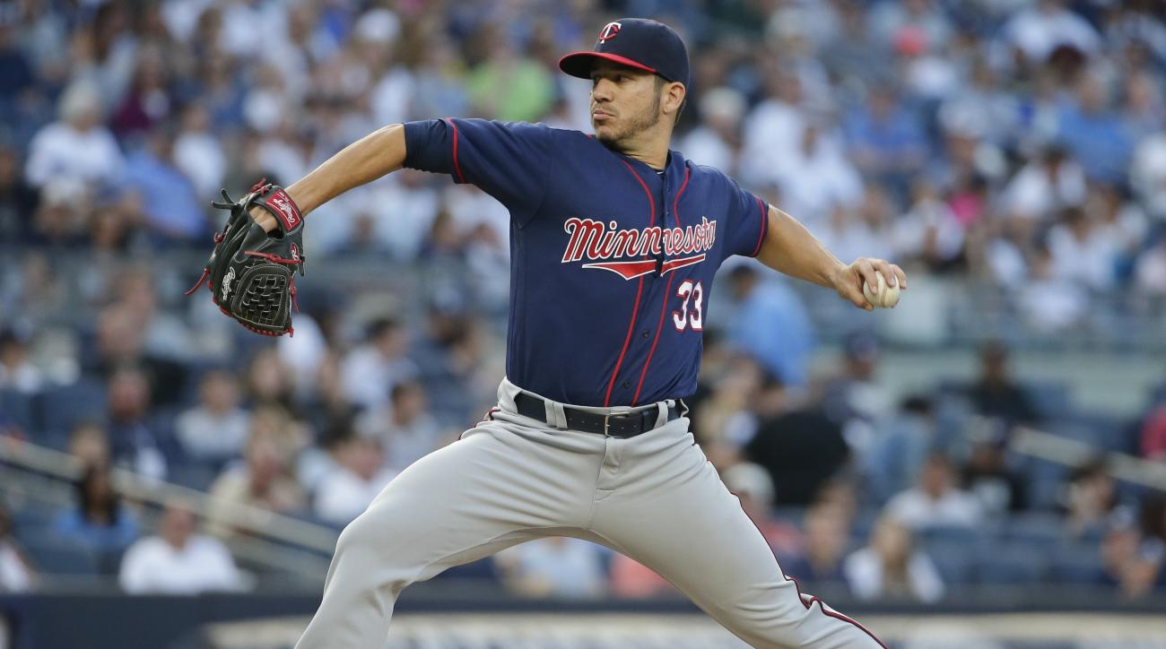 Minnesota Twins' Tommy Milone (33) winds up during the second inning of the team's baseball game against the New York Yankees on Friday, June 24, 2016, in New York. (AP Photo/Frank Franklin II)