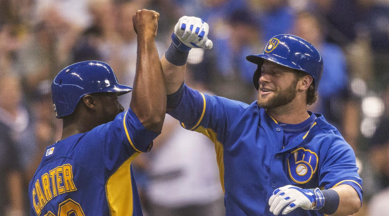 Milwaukee Brewers' Kirk Nieuwenhuis, right, is greeted by Chris Carter after hitting a two-run home run off of Washington Nationals' Max Scherzer during the sixth inning of a baseball game Friday, June 24, 2016, in Milwaukee. (AP Photo/Tom Lynn)