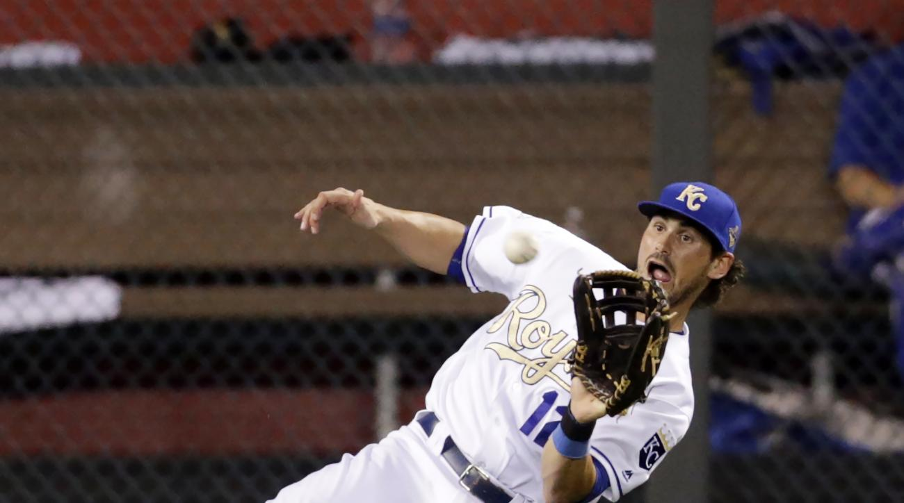 Kansas City Royals left fielder Brett Eibner (12) catches a fly ball for an out in the sixth inning of a baseball game against the Houston Astros at Kauffman Stadium in Kansas City, Mo., Friday, June 24, 2016. (AP Photo/Colin E. Braley)