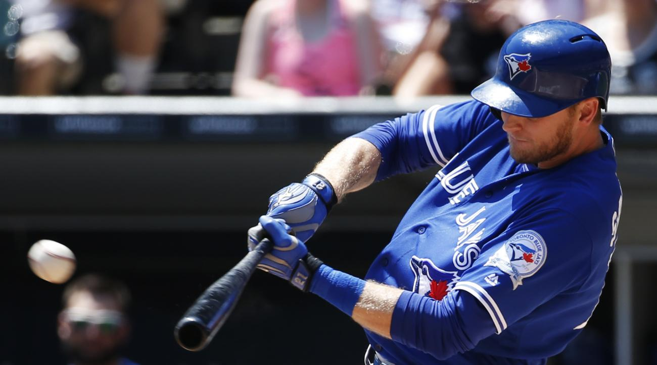 Toronto Blue Jays' Michael Saunders hits an RBI double against the Chicago White Sox during the first inning of a baseball game in Chicago, Saturday, June 25, 2016. (AP Photo/Nam Y. Huh)