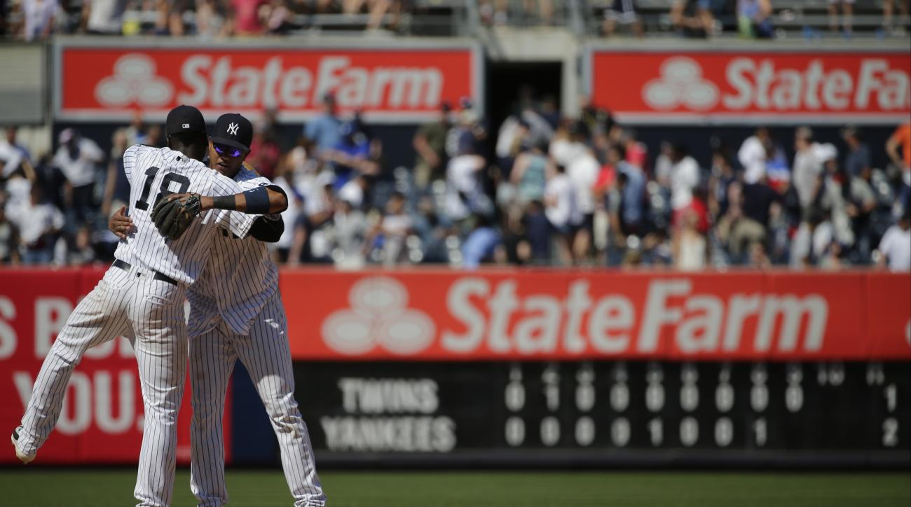New York Yankees' Starlin Castro, right, hugs Didi Gregorius after a baseball game against the Minnesota Twins Saturday, June 25, 2016, in New York. The Yankees won 2-1. (AP Photo/Frank Franklin II)