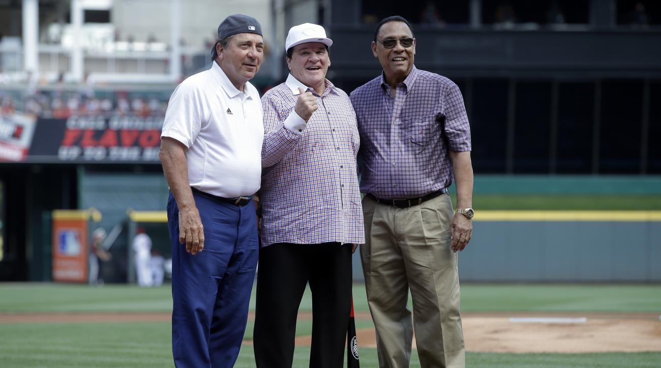 Former Cincinnati Reds players, from left, Johnny Bench, Pete Rose, and Tony Perez, stand on the field together during a ceremony to induct Rose into the Cincinnati Reds Hall of Fame before a baseball game against the San Diego Padres, Saturday, June 25,
