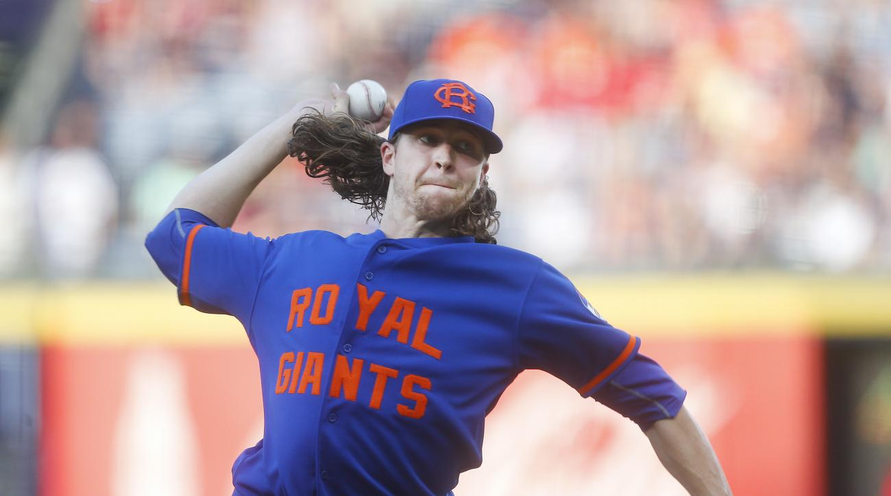 New York Mets starting pitcher Jacob deGrom throws to an Atlanta Braves batter in the first inning of a baseball game Saturday, June 25, 2016, in Atlanta. (AP Photo/John Bazemore)