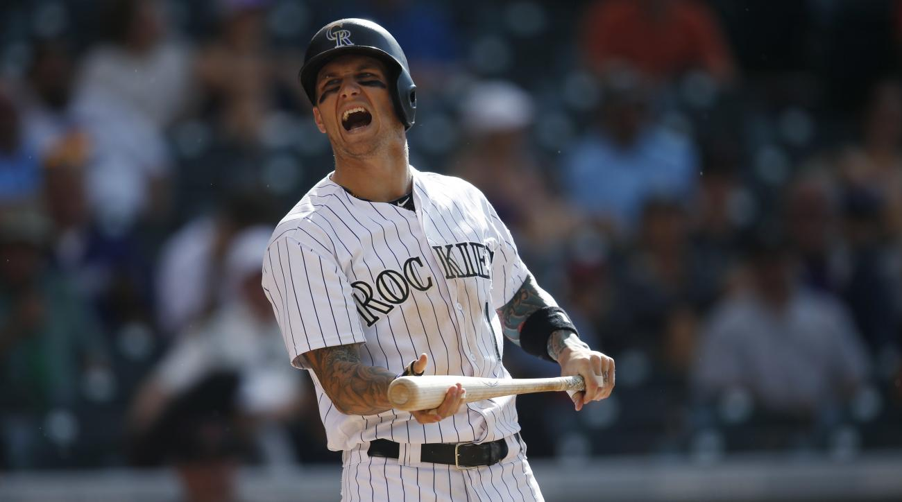 Colorado Rockies' Brandon Barnes reacts after an inside pitch from Arizona Diamondbacks reliever Josh Collmenter in the eighth inning of a baseball game Saturday, June 25, 2016, in Denver. (AP Photo/David Zalubowski)