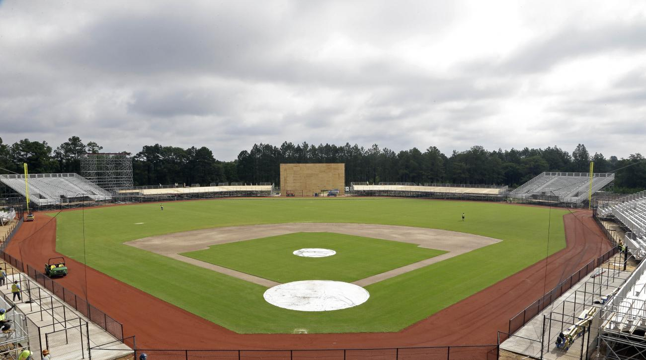 In this photo taken Thursday, June 16, 2016, work continues to install a baseball field on post at Fort Bragg, N.C. The Atlanta Braves and Miami Marlins will play a salute-the-troops game at this vast U.S. Army post the night before Independence Day. (AP