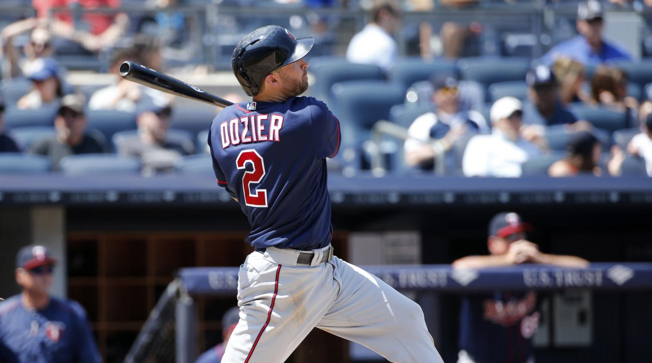 Minnesota Twins Brian Dozier (2) watches his two-run home run off New York Yankees starting pitcher Nathan Eovaldi during a baseball game in New York, Sunday, June 26, 2016. (AP Photo/Kathy Willens)