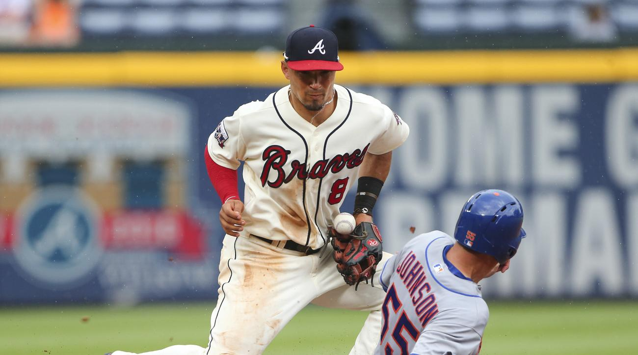 New York Mets' Kelly Johnson (55) steals second base as Atlanta Braves second baseman Jace Peterson (8) handles the throw in the sixth inning of a baseball game Sunday, June 26, 2016, in Atlanta. (AP Photo/John Bazemore)