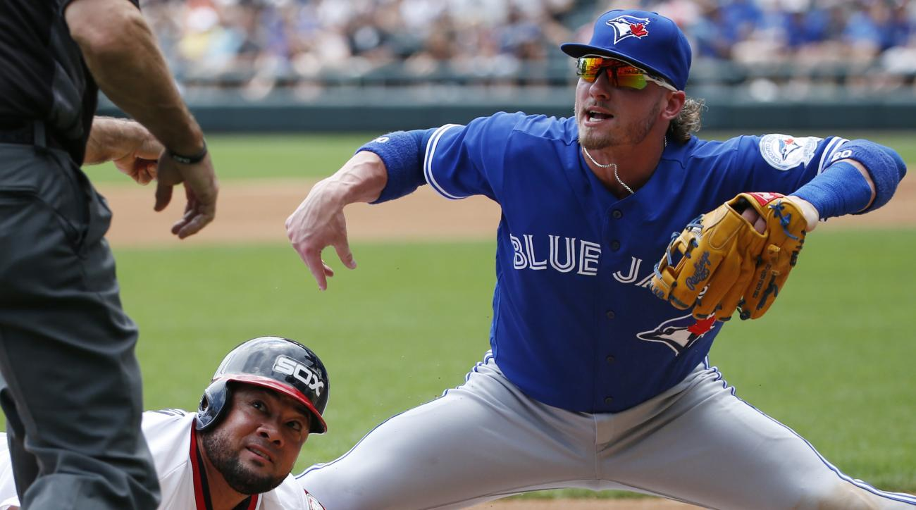 4Toronto Blue Jays third baseman Josh Donaldson, right, reacts after tagging out Chicago White Sox's Melky Cabrera, bottom, at third during the second inning of a baseball game in Chicago, Sunday, June 26, 2016. (AP Photo/Nam Y. Huh)
