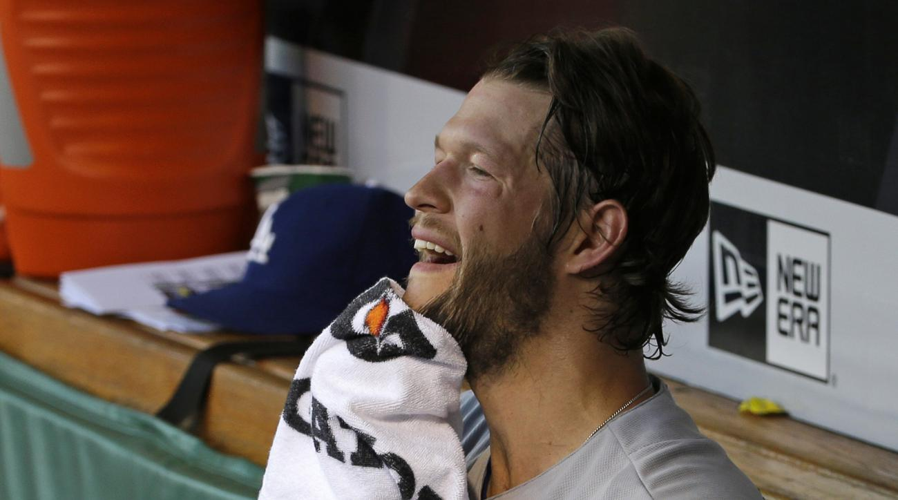 Los Angeles Dodgers starting pitcher Clayton Kershaw wipes his face in the dugout during a baseball game against the Pittsburgh Pirates in Pittsburgh, Sunday, June 26, 2016. The Pirates won 4-3. (AP Photo/Gene J. Puskar)
