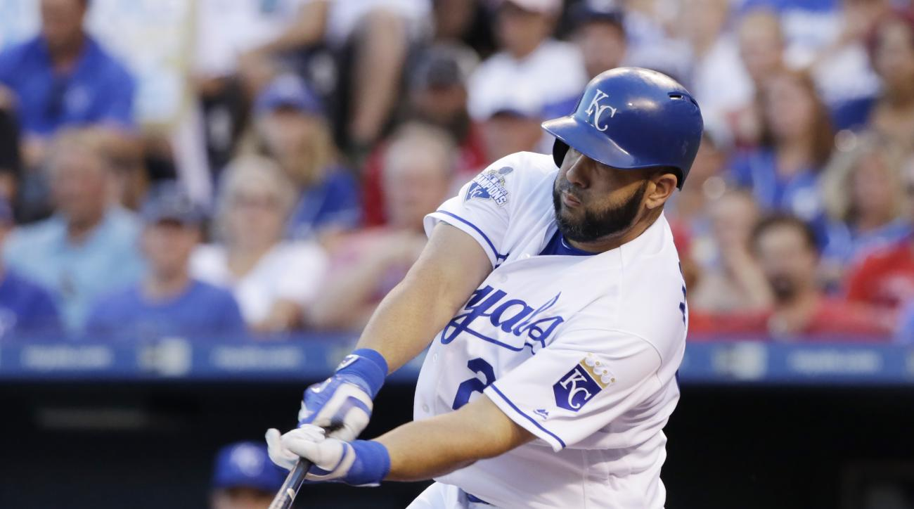 Kansas City Royals designated hitter Kendrys Morales hits a single for two RBI's in the first inning of a baseball game against the St. Louis Cardinals in Kansas City, Mo., Monday, June 27, 2016. (AP Photo/Colin E. Braley)